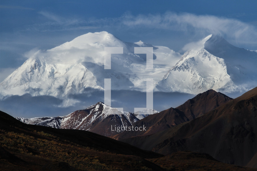 snow capped mountains and layers of a mountain landscape