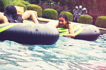 girl children playing in inner tubes