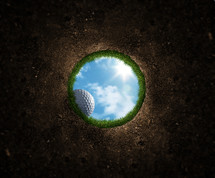 golf ball rolling into a hole