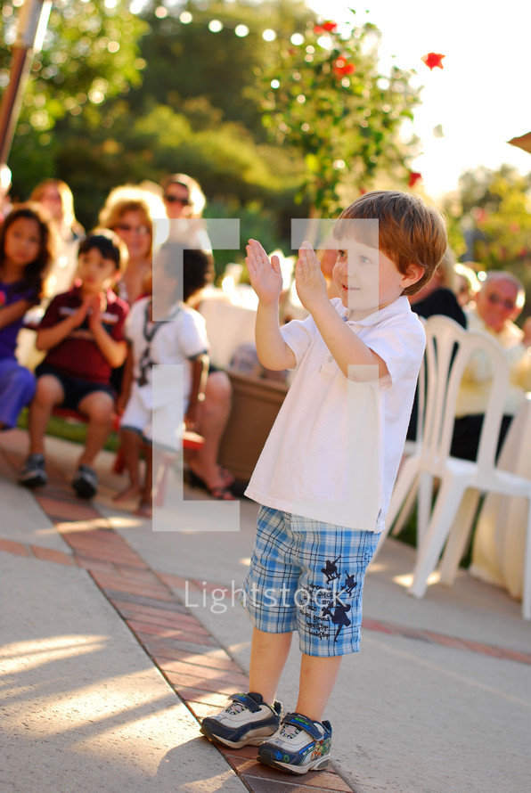 toddler boy clapping his hands