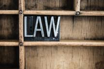 word law in blocks on a bookshelf
