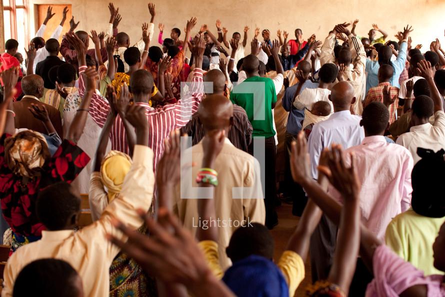 raised hands in an African church
