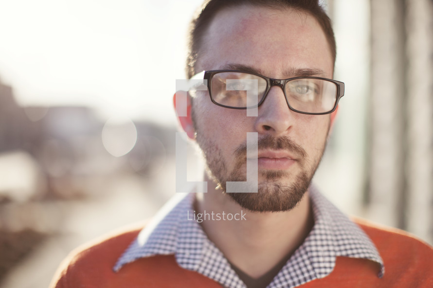 face of a man wearing reading glasses