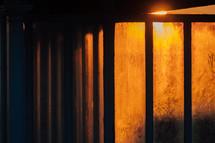 glowing lights against dark walls