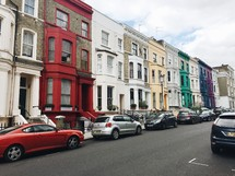 a row of rainbow colored row houses