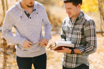 Two Guys Studying the bible outside during Fall