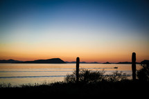 silhouettes of distant island mountains