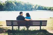 couple sitting on a park bench together