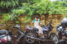 child sitting on a motorcycle