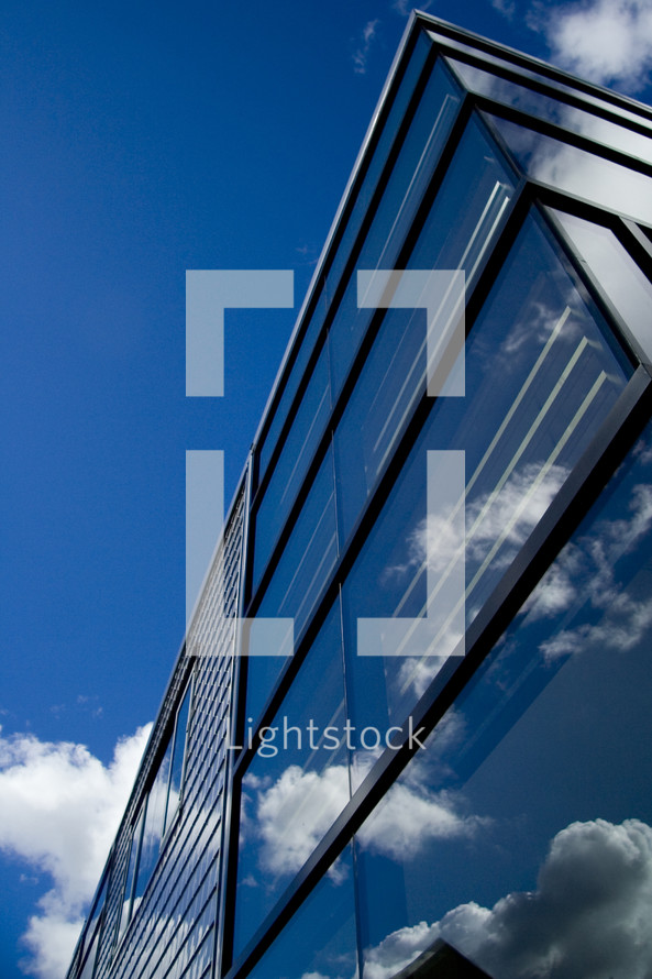 Sky reflection on office building