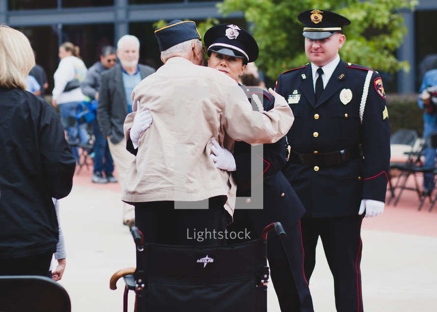 A Veteran hugging a police officer