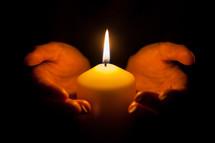 holding a burning candle