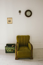 a green armchair in a room