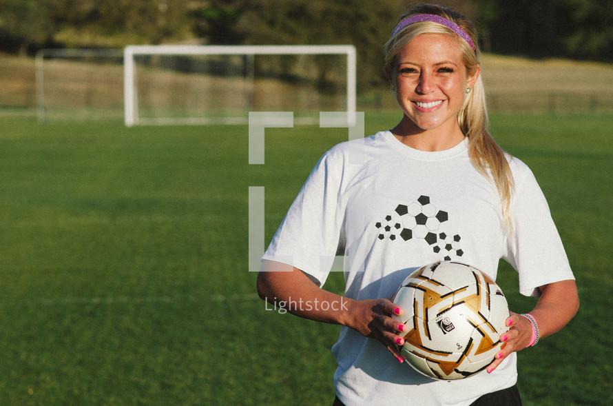 teen girl holding a soccer ball