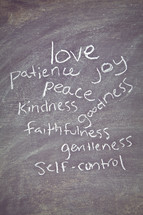 The Fruit of the Spirit - love, patience, joy, peace, kindness, faithfulness, goodness, gentleness, and self-control written on a chalkboard