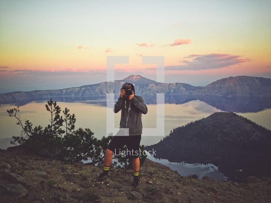 man taking photographs