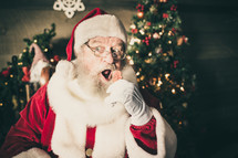 Santa holding a cookie