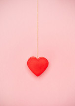 red heart on pink background