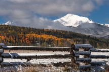 Snow covered mountain above autumn colors