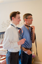 father and son putting on ties