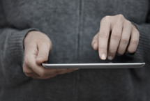 a peson touching an iPad screen