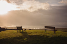 benches on a hilltop overlooking the ocean