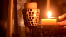match lighting a candle