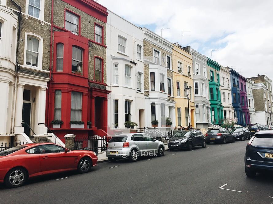 a row of rainbow colored row houses