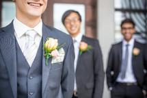 boutonnieres on groomsmen