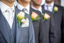 boutonnieres on groomsmen