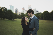 a couple hugging in a city park