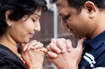 An Indian couple in prayer together