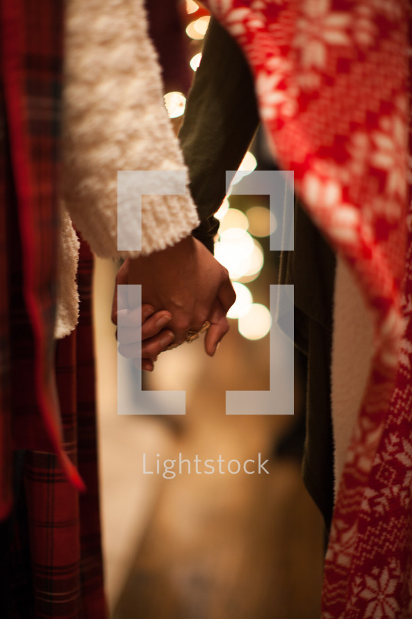 people holding hands in prayer at a Christmas party