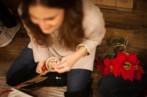 women sitting on the floor at a Christmas party and poinsettias