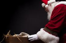Santa visiting baby Jesus in the manger