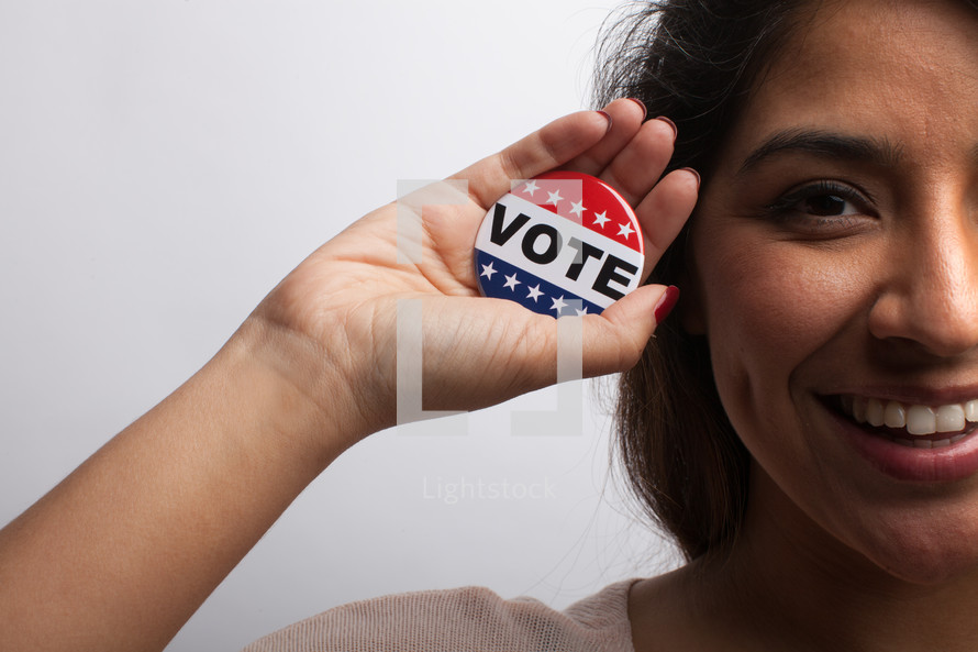 young woman with vote button