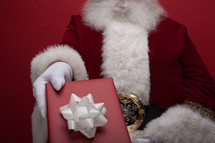 Santa giving a Christmas gift