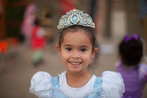 a little girl in a princess costume