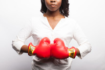 young woman in red boxing gloves