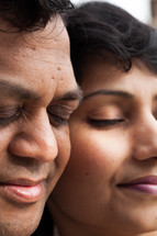 faces of an Indian couple in prayer