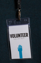 A plastic badge for a volunteer.