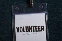Plastic badge holder and clip for a volunteer.