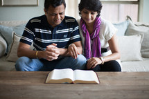 an Indian couple reading a Bible