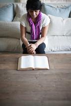 An Indian woman reading a Bible