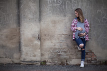 teen girl holding her pregnant belly