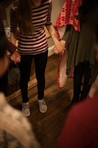 teens holding hands in prayer at a Christmas party