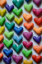 many colorful little hearts.  heart, hearts, love, brothers, sisters, siblings, one another, congregation, unit, form, build, shape, grow, church, christians, each, many, part, parts, nations, together, different, international, body of christ, peoples, appointment, reunion, union, cultures, various, several, diverse, color, colorful, multicolored, symbol, letter, knead, kneading, clay, dough