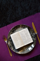 bible opened up at Matthew 4:4  on a plate