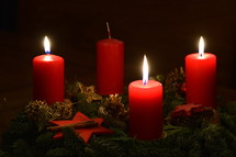Three candles are burning at the Advent wreath for the third advent.