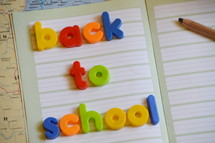 BACK TO SCHOOL in colorful magnetic letters, 